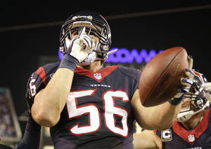 Photo - Houston Texans inside linebacker Brian Cushing celebrates a touchdown against the San Diego Chargers during the second half of an NFL football game Monday, Sept. 9, 2013, in San Diego. (AP Photo/Gregory Bull)