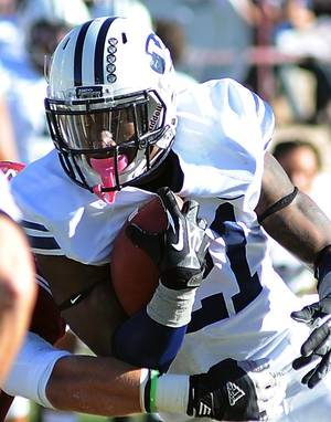 Photo - Brigham Young's Jamaal Williams runs with the ball against New Mexico State during an NCAA college football game on Saturday, Nov. 24, 2012, in Las Cruces, N.M. (AP Photo/Las Cruces Sun-News, Robin Zielinski)