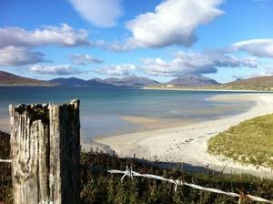 Photo - This October 2013 photo shows the startling white-sand beaches on the west coast of the Outer Hebrides in Scotland. The beaches are an easy draw for travelers, though getting into the cold water above your ankles in cooler weather takes some courage _ and a squeal. (AP Photo/Cara Anna)