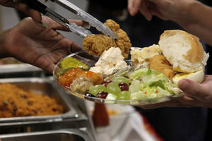 photo - Samples of food are served up at a  preview for Global Oklahoma at  Rose State College in Midwest City. Photo by Silas Allen, The Oklahoman <strong>Silas Allen</strong>