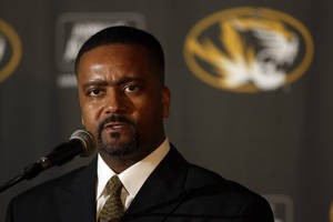 Photo - New University of Missouri head basketball coach Frank Haith is introduced during a news conference Tuesday, April 5, 2011, in Columbia, Mo. Haith comes to Missouri after seven seasons as head coach at the University of Miami. (AP Photo/Jeff Roberson) ORG XMIT: MOJR101