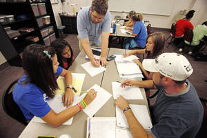 Photo - Instructor Daniel Benton works with Lauren McKenzie, Bhavini Patel, Kylie Ingram and Tripp Robertson in a math class at Oklahoma City Community College. Photos by David McDaniel, The Oklahoman