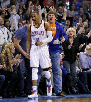 photo - Oklahoma City's Russell Westbrook (0) reacts after a basket during an NBA basketball game between the Oklahoma City Thunder and the Dallas Mavericks at Chesapeake Energy Arena in Oklahoma City, Thursday, Dec. 27, 2012.  Oklahoma City won 111-105. Photo by Bryan Terry, The Oklahoman