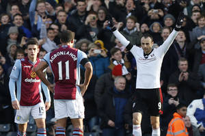 Photo - Fulham's Dimitar Berbatov, right, celebrates his penalty goal against Aston Villa during their English Premier League soccer match at Craven Cottage, London, Sunday, Dec. 8, 2013. (AP Photo/Sang Tan)