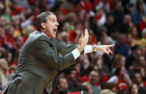 Photo - Washington Wizards head coach Randy Wittman gestures to an official during the second half of Game 5 in an opening-round NBA basketball playoff series against the Chicago Bulls, Tuesday, April 29, 2014, in Chicago. The Wizards won 75-69. (AP Photo/Charles Rex Arbogast)