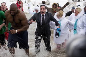 "Photo - ""The Tonight Show"" host Jimmy Fallon, center, exits the water during the Chicago Polar Plunge, Sunday, March 2, 2014, in Chicago. Fallon joined Chicago Mayor Rahm Emanuel in the event. (AP Photo/Andrew A. Nelles)"