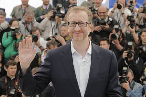 Photo - Director James Gray gestures as he poses for photographers during a photo call for the film The Immigrant at the 66th international film festival, in Cannes, southern France, Friday, May 24, 2013. (AP Photo/Francois Mori)