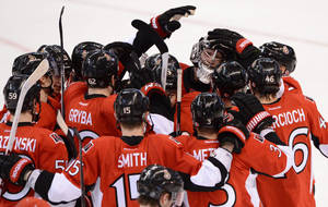 Photo - Ottawa Senators goaltender Ben Bishop is congratulated by teammates as they celebrate their 2-1 shootout win against the Montreal Canadiens in their NHL hockey game, Monday, Feb. 25, 2013, in Ottawa, Ontario. (AP Photo/The Canadian Press, Sean Kilpatrick)
