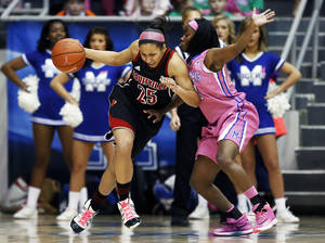 Photo - Louisville guard Tia Gibbs (25) runs into Memphis guard Ariel Hearn in the first half of an NCAA college basketball game on Sunday, Feb. 16, 2014, in Memphis, Tenn. (AP Photo/Yalonda M. James)