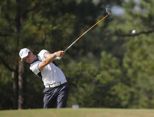 Photo - Martin Kaymer, of Germany, watches his tee shot on the 10th hole during the final round of the U.S. Open golf tournament in Pinehurst, N.C., Sunday, June 15, 2014. (AP Photo/Matt York)