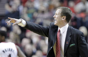 Photo - Portland Trail Blazers coach Terry Stotts gestures from the bench during the second half of an NBA basketball game against the New Orleans Pelicans in Portland, Ore., Saturday, Dec. 21, 2013. Portland won 110-107. (AP Photo/Don Ryan)