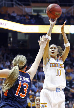 Photo - Tennessee guard Meighan Simmons (10) shoots over Auburn guard/forward Katie Frerking (13) in the first half of an NCAA college basketball game, Thursday, Feb. 20, 2014, in Knoxville, Tenn. (AP Photo/Wade Payne)
