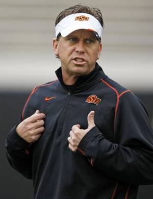 photo - OKLAHOMA STATE UNIVERSITY COLLEGE FOOTBALL: Todd Monken, OSU offensive coordinator and quarterbacks coach, during Oklahoma State spring football practice at Boone Pickens Stadium in Stillwater, Okla., Monday, March 7, 2011. Photo by Nate Billings, The Oklahoman ORG XMIT: KOD