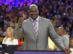 Photo - FILE - In this April 2, 2013, file photo, former Los Angeles Lakers center Shaquille O'Neal gestures during ceremonies to retire his jersey during halftime of an NBA game between the Lakers and Dallas Mavericks, in Los Angeles. O'Neal is joining the ownership group of the Sacramento Kings. The Kings announced Monday, Sept. 23, 2013, that O'Neal has acquired a minority stake in the team under new owner Vivek Ranadive. The Kings will introduce the four-time NBA champion at a news conference Tuesday in Sacramento. (AP Photo/Mark J. Terrill, File)