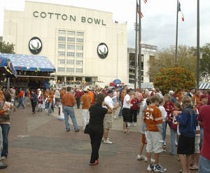 Photo - FAN: Football fans from Texas and Oklahoma mingle outside the Cotton Bowl Stadium prior to the University of Oklahoma Sooners (OU) college football game against the University of Texas (UT), at the Cotton Bowl in Dallas, Saturday, October 8, 2005. The game is the 100th in the series of the Red River Rivalry. By Steve Sisney/The Oklahoman