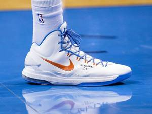 "Photo - Thunder star Kevin Durant honored the victims in Newtown, Conn., on Friday by writing ""NEWTOWN CT"" on his shoes in the Thunder's 113-103 win against the Kings. Photo provided by Richard Rowe, Oklahoma City Thunder <strong></strong>"
