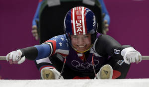 Photo - Kate Hansen of the United States starts a run during the women's singles luge training at the 2014 Winter Olympics, Sunday, Feb. 9, 2014, in Krasnaya Polyana, Russia. (AP Photo/Michael Sohn)
