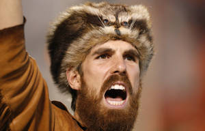 Photo - The Mountaineer shouts during a college football game between Oklahoma State University (OSU) and West Virginia University at Boone Pickens Stadium in Stillwater, Okla., Saturday, Nov. 10, 2012. Oklahoma State won 55-34. Photo by Bryan Terry, The Oklahoman