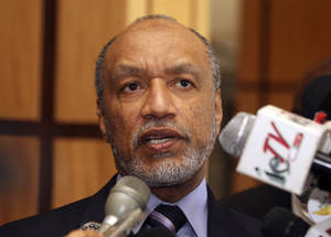 photo - FILE - In this May 10, 2011 file picture Mohamed bin Hammam, chief of the Asian Football Confederation, talks to local media in Port of Spain, Trinidad &amp; Tobago. Former FIFA presidential candidate Mohamed bin Hammam resigned from all football-related positions and was banned for life by world footballs governing body following repeated violations of its code of ethics while head of the Asian Football Confederation, it has been reported Monday, Dec. 17, 2012. Bin Hammam, who is an executive committee member, sent a resignation letter to both FIFA and the AFC on Dec. 15. The 63-year-old Qatari has also been fighting a life ban imposed by FIFA following allegations that he offered bribes to voters when running against incumbent Sepp Blatter in the presidential election.  (AP Photo/Shirley Bahadur, File)