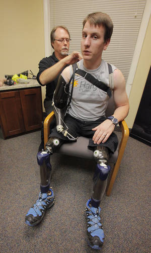 "photo - ""What's It Like"" to get fitted for a prosthetic.  Chuck Anderson, an upper extremity specialist, fits triple amputee Captain Jonathan White, a British Royal Marine Commando,  injured in Afghanistan in 2010, at the Hanger Clinic, Friday, September 28, 2012. Photo By David McDaniel/The Oklahoman"