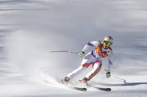 Photo - Liechtenstein's Tina Weirather coles to a halt at the end of a women's downhill training run for the Sochi the 2014 Winter Olympics, Friday, Feb. 7, 2014, in Krasnaya Polyana, Russia. (AP Photo/Gero Breloer)