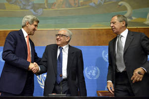 "Photo - John Kerry, left, US Secretary of State, shakes hands with Lakhdar Brahimi, center, UN Joint Special Representative for Syria, next to Sergei Lavrov, right, Russian Foreign Minister during a press conference after their meeting at the European headquarters of the United Nations in Geneva, Switzerland, Friday, Sept. 13, 2013. Kerry and Lavrov say the prospects for a resumption in the Syria peace process are riding on the outcome of their chemical weapons talks. Kerry, flanked by Lavrov and Brahimi, told reporters after an hour-long meeting that the chances for a second peace conference in Geneva ""will obviously depend on the capacity to have success here ... on the subject of the chemical weapons."" (AP Photo/Keystone, Martial Trezzini)"