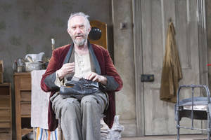 "Photo -   In this undated image released by the Brooklyn Academy of Music, actor Jonathan Pryce is shown during a performance of ""The Caretaker,"" in New York. (AP Photo/BAM, Shane Reid)"