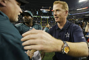 Photo - Dallas Cowboys head coach Jason Garrett greets members of the Philadelphia Eagles after an NFL football game, Sunday, Dec. 29, 2013, in Arlington, Texas. The Eagles won 24-22. (AP Photo/Tony Gutierrez)