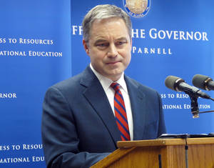 photo - Alaska Gov. Sean Parnell listens to a reporter's question during a news conference on Thursday, Feb. 28, 2013, in Juneau, Alaska. Parnell announced that he is opposed to expansion of the Medicaid program at this time, given what he knows about the budget situation in Washington, D.C., but would revisit the issue later. (AP Photo/Becky Bohrer)