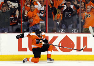 Photo -   Philadelphia Flyers center Danny Briere (48) reacts after his goal in the second period of Game 1 against the New Jersey Devils in a second-round NHL Stanley Cup hockey playoff series, Sunday, April 29, 2012, in Philadelphia. (AP Photo/Alex Brandon)
