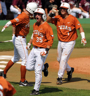 Photo - Texas' Madison Carter, center, celebrates after scoring during the third inning against Texas A&M in an NCAA college baseball tournament regional game Friday, May 30, 2014, at Reckling Park in Houston. (AP Photo/Houston Chronicle, Eric Christian Smith) MANDATORY CREDIT