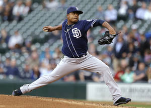 Photo - San Diego Padres starting pitcher Edinson Volquez throws to a Seattle Mariners batter in the first inning of a baseball game Tuesday, May 28, 2013, in Seattle. (AP Photo/Elaine Thompson)