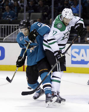 Photo - San Jose Sharks' Justin Braun (61) collides with Dallas Stars' Rich Peverley (17) during the second period of an NHL hockey game on Wednesday, Feb. 5, 2014, in San Jose, Calif. (AP Photo/Marcio Jose Sanchez)