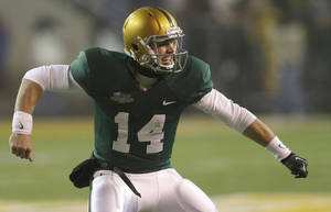 Photo - Baylor quarterback Bryce Petty (14) celebrates scoring a touchdown during the second half of an NCAA college football game against Texas, Saturday, Dec. 7, 2013, in Waco, Texas. Baylor won 30-10. (AP Photo/LM Otero)