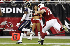 Photo -   St. Louis Rams' Janoris Jenkins, left, returns an interception for a touchdown as Arizona Cardinals' Nate Potter gives chase during the second half of an NFL football game, Sunday, Nov. 25, 2012, in Glendale, Ariz. The Rams won 31-17. Jenkins became the first player in Rams history and the first NFL rookie since 1960 to return two interceptions for touchdowns in the same game. (AP Photo/Ross D. Franklin)