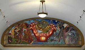"Photo - The mural, ""Beyond the Centennial,"" by Carlos Tello is creating controversy at the Capitol. <strong>CHRIS LANDSBERGER - THE OKLAHOMAN</strong>"