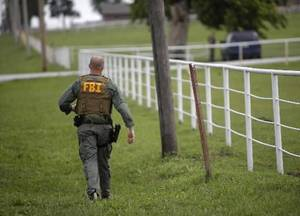Photo - Federal agents converge at Zule Farms in Lexington, Tuesday, June 12, 2012. The multi-state raid targeted the brother of a high-ranking official in a Mexican drug cartel for allegedly using a horse-breeding operation to launder money. Photo by Garett Fisbeck