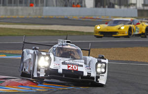 Photo - The Porsche 919 driven by Timo Bernhard of Germany, Mark Webber of Australia, and Bredon Hartley of New Zealand, in a curve of the Mans circuit, during a free practice session for the 24-hour Le Mans endurance race, in Le Mans, western France, Wednesday, June 11, 2014. The race will take place on Saturday and Sunday. (AP Photo/Remy de la Mauviniere)