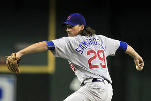photo -   Chicago Cubs&#039; Jeff Samardzija throws against the Arizona Diamondbacks during the third inning in a baseball game on Friday, June 22, 2012, in Phoenix.(AP Photo/Ross D. Franklin)  