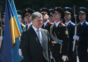Photo - CORRECTS DATE - Ukrainian President Petro Poroshenko reviews an honor guard after the inauguration ceremony in Sophia Square in Kiev, Ukraine, Saturday, June 7, 2014. Petro Poroshenko took the oath of office as Ukraine's president Saturday, assuming leadership of a country mired in a violent uprising and economic troubles. (AP Photo/Sergei Chuzavkov)