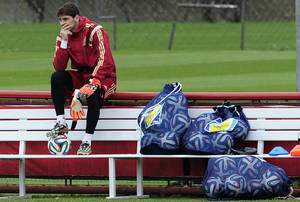 Photo - Spain's goalkeeper Iker Casillas looks on during a training session at the Atletico Paranaense training center in Curitiba, Brazil, Friday, June 20, 2014. Spain  play in group B of the Brazil 2014 World Cup. (AP Photo/Manu Fernandez)