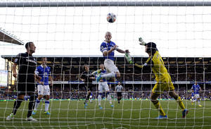 Photo - Everton's Steven Naismith, center, scores against Chelsea during the English Premier League soccer match at Goodison Park, Liverpool, England, Saturday Sept. 14, 2013. (AP Photo/PA, Peter Byrne) UNITED KINGDOM OUT  NO SALES  NO ARCHIVE