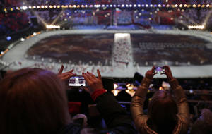 Photo - FILE - In this  Friday, Feb. 7, 2014, file photo, a spectator takes a video of the opening ceremony on her mobile phone at the 2014 Winter Olympics in Sochi, Russia.  (AP Photo/Charlie Riedel, File)