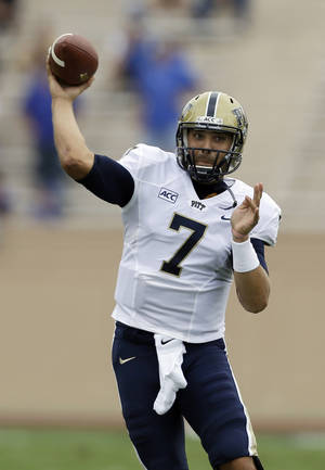 Photo - Pittsburgh quarterback Tom Savage passes during the first half of an NCAA college football game against Duke in Durham, N.C., Saturday, Sept. 21, 2013. Pittsburgh won 58-55. (AP Photo/Gerry Broome)