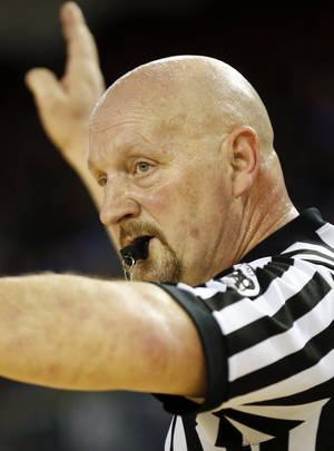 Photo - Referee Butch Vietta, of Atoka, Okla., during a Class B girls semifinal high school basketball game in the state championship tournament between Okarche and Erick at The Big House, Jim Norick State Fair Arena, in Oklahoma City, Friday, March 7, 2014. Photo by Nate Billings, The Oklahoman