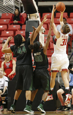Photo - Texas Tech's Haley Schneider (31) scores over Baylor's Kristina Higgins (44) and Imani Wright (20) during an NCAA college basketball game in Lubbock, Texas, Wednesday, Feb. 12, 2014. (AP Photo/The Avalanche-Journal, Tori Eichberger)