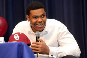 Photo - Oklahoma signee Orlando Brown, from Duluth, Ga., talks after signing his National Letter of Intent on Wednesday at a signing ceremony at Peachtree Ridge High School. PHOTO BY BRENDAN SULLIVAN, Courtesy Gwinnett Daily Post <strong></strong>