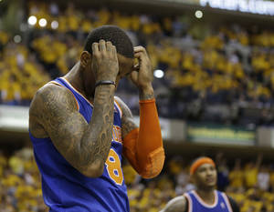 Photo - New York Knicks' J.R. Smith reacts late during the second half of Game 6 of an Eastern Conference semifinal NBA basketball playoff series against the Indiana Pacers, Saturday, May 18, 2013, in Indianapolis. Indiana defeated New York 106-99 to win the series 4-2. (AP Photo/Darron Cummings)