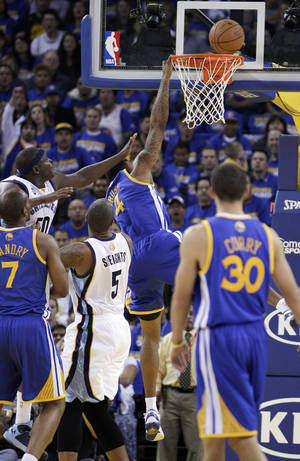 Photo -   Memphis Grizzlies' Zach Randolph (50) makes contact with Golden State Warriors' Brandon Rush (4) during the first half of an NBA basketball game Friday, Nov. 2, 2012, in Oakland, Calif. Rush left the game with an injured knee after this play. (AP Photo/Ben Margot)