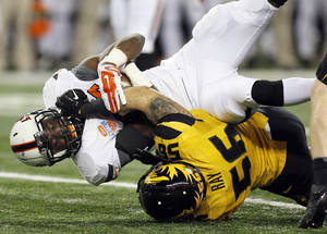 Photo - Missouri's Shane Ray (56) stops Oklahoma State's Desmond Roland (26) on a carry during the AT&T Cotton Bowl Classic college football game between the Oklahoma State University Cowboys (OSU) and the University of Missouri Tigers at AT&T Stadium in Arlington, Texas, Friday, Jan. 3, 2014. Photo by Nate Billings, The Oklahoman